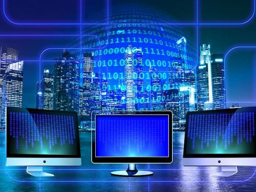 Screens connected by a stream of binary code