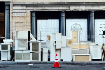 Image of kitchen cabinets placed by the side of the road for disposal